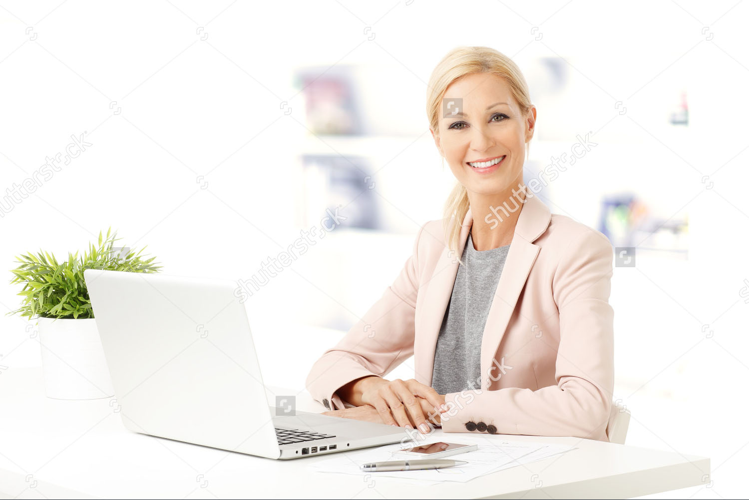stock-photo-portrait-of-middle-age-woman-sitting-at-office-and-working-beautiful-businesswoman-sitting-at-desk-315067514